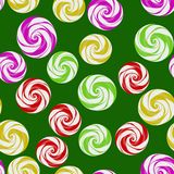 Set of Colorful Sweet Candy. Colorful Sweet Candy Seamless Pattern on Green Background Royalty Free Stock Image