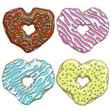 Set of colorful tasty donuts in the form of a heart. Royalty Free Stock Photo