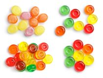 Set of colorful tasty hard candies on white background. Top view stock photos