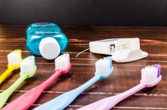 Set of colorful toothbrush with mount wash and dental floss on b Stock Images