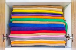 Set of colorful towels for bathroom are perfectly placed. New colour towels pile on shelves Stock Photos