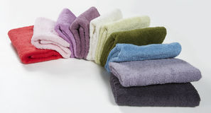 Set of colorful towels folded like a fan, isolated on white back Royalty Free Stock Images