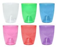 Set of colorful transparent plastic  pots for orchid plants royalty free stock photography