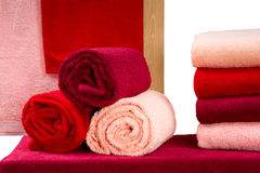 Set of colorful twisted terry towels isolated on white background Stock Photo