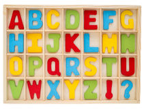 Set of colorful uppercase alphabet. English letter a to z collection in wooden box Stock Photography