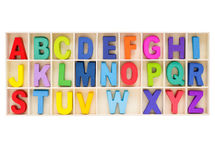Set of colorful uppercase alphabet letter in the box. Set of colorful uppercase alphabet, english letter a to z collection in wooden box Stock Image