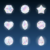 Set of colorful vector jewels gemstones and crystals with glowing on dark background.  Royalty Free Stock Image