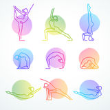 Set of colorful vector line figures in various yoga poses Stock Image