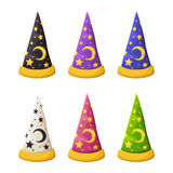 Set of colorful wizard's hats  on a white background. Vector illustration. Vector set of colorful wizard's hats with stars  on a white background Stock Image