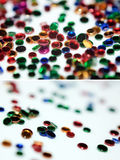 Set of colour plastic rounds. Colour round tablets of plastic close up with shallow depth of field Stock Image