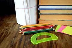 Set of coloured pencils, stickers, books and protractor stock photography