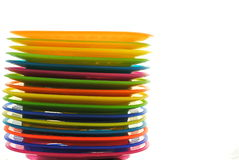 Set of coloured plastic dishes. On white background Stock Photo