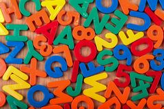 Set of coloured plastic letters and numbers.  stock image