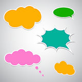 Set of colourful comic speech bubbles. On grey background Royalty Free Stock Photo
