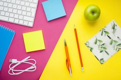 Set of colourful stickers, white keyboard, notebook and snacks. stock image