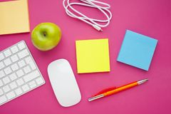 Set of colourful stickers, white keyboard, notebook and snacks. stock photography