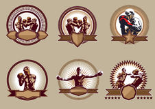 Set of combative sport icons or emblems. Set of six different vector combative sport icons or emblems showing a single boxer fighting, two boxers sparring and a Royalty Free Stock Photos