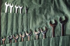 Set of combination wrenches on green fabric for repairing and fixed. Concept Royalty Free Stock Image