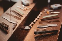 Hairdresser`s tools: combs, scissors, clip-on hair clipper. Set of combs. Hairdresser`s tools: combs, scissors, clip-on hair clipper royalty free stock image