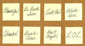 Set of common phrases on yellow post it notes. Isolated on cork board Royalty Free Stock Photos