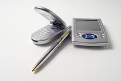 Set of communication Tools. PDA, cell phone and pen Royalty Free Stock Images