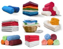 Set of compositions with colorful towels isolated. Colorful set towels compositions white objects background Stock Images