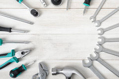 Set of construction instruments and tools placed on wooden surface with copy space Royalty Free Stock Images