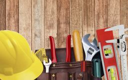 Set of construction tooling in tool belt hard hat Stock Image