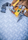 Set of construction tooling in toolbelt on channeled metal backg Stock Photo