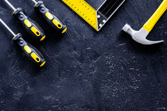 Set of construction tools on balck stone desk background top view Royalty Free Stock Image