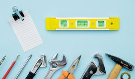 Set of construction tools on blue flat lay as wrench, hammer, pl. Iers, socket wrench, spanner, water balance, electric drill, screwdriver. Fathers day royalty free stock image