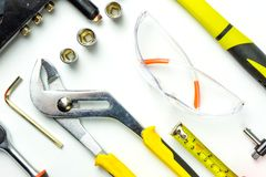Set of construction tools on white background as wrench, hammer, pliers, socket wrench, spanner, tape measure, electric royalty free stock photo