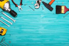 A set of construction tools on a wooden background. The concept of celebrating the father`s day. royalty free stock image