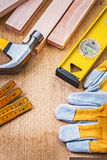 Set of construction tools on wooden board Stock Images