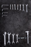 Set of construction tools, wrenches and spanners on black Royalty Free Stock Photo