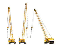 Set of construction yellow crawler cranes isolated Royalty Free Stock Images