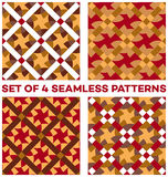 Set of 4 contemporary geometric seamless patterns with different geometric elements of bronze, orange, olive, red and white shades Royalty Free Stock Photo
