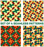 Set of 4 contemporary geometric seamless patterns with different geometric elements of golden, beige, green, red, blue and orange. Set of 4 abstract contemporary Royalty Free Stock Photo