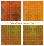 Set of 4 contemporary geometric seamless patterns with different size squares of brown, orange, yellow and green shades Royalty Free Stock Photos