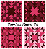Set of 4 contemporary geometric seamless patterns with triangles and squares of burgundy, purple, cherry and pink colors Royalty Free Stock Photo