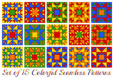 Set of 15 contemporary rainbow geometric seamless patterns with triangles and squares of red, blue, green, orange and yellow shade Royalty Free Stock Photography