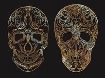 Set of contour gold illustrations of a sugar skulls. The holiday of the Day of the Dead. Vector element for your creativity Royalty Free Stock Photography