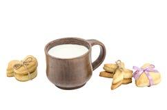 Set of cookies and cap of milk Stock Photos