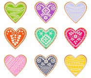 Set of cookies in form of hearts. Valentine`s Day. Vector. Vector set of curly cookies in form of hearts with multi-colored icing on white background. Holiday of Royalty Free Stock Images
