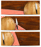 Set of Cooking Banners. Cooking banners with round cutting board, red checked tablecloth on wooden table and kitchen knife isolated on white Stock Images