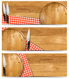 Set of Cooking Banners. Cooking banners with round cutting board, red checked tablecloth on wooden table and kitchen knife isolated on white Royalty Free Stock Photos