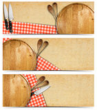Set of Cooking Banners. Cooking banners with round cutting board, red checked tablecloth on yellowed paper, kitchen knife and wooden spoons isolated on white Stock Images
