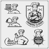 Set of cooking classes with chef cook emblems, labels and design elements. royalty free stock image