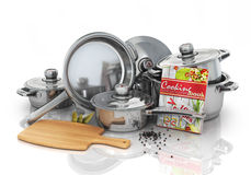 Set of cooking pots with cookbook and board for rifling. Kitchen Stock Image