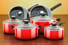 Set of cooking red kitchen utensils and cookware. Pots and pans. On the wooden table. 3D Royalty Free Stock Photo